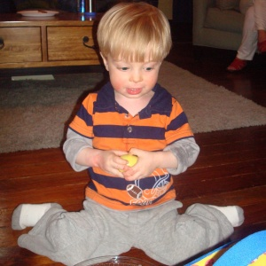 "When a child w-sits he spreads his hips with his bottom on the floor, his knees bent, and his feet behind him, making a ""W"" shape with his legs."